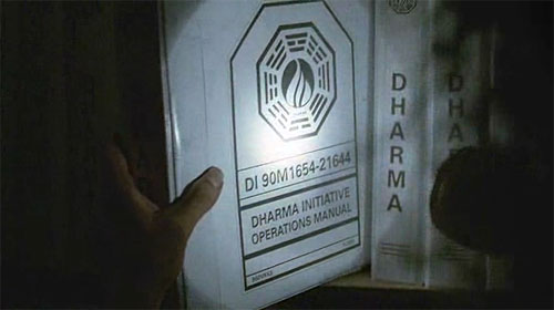 Sayid examines DHARMA Initiative manuals